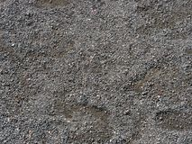 Dirty, pebble pattern on ground Stock Photography