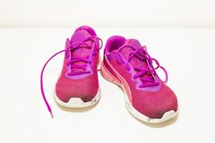 Dirty pink sneakers. Pink dirty sneakers. Pair of bright pink muddy sport  shoes on 399081873