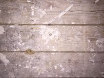 Dirty plaster covered wooden floorboards Royalty Free Stock Images
