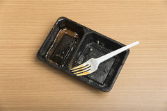 Dirty plastic food container Stock Photo