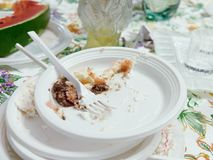 Dirty plastic plates finished party. Dirty plastic plates at finished party royalty free stock photos