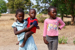 Dirty and poor Namibian childrens Stock Photos