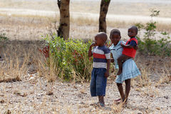 Dirty and poor Namibian childrens Stock Photo