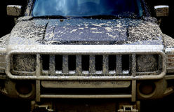 Dirty power 4x4 car on black background Royalty Free Stock Photos