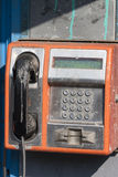 Dirty public phone Royalty Free Stock Image