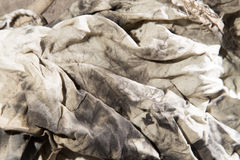 Dirty rags in oil as background. A photo Stock Images