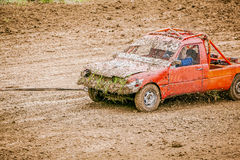 Dirty rally car trailing Stock Photos