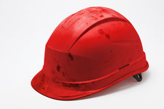 Dirty red hard hat Stock Photography