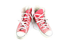 Dirty red sneaker isolated. Royalty Free Stock Photography