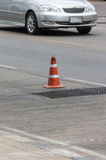 Dirty red traffic cone Stock Images