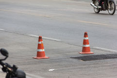 Dirty red traffic cone Stock Photo