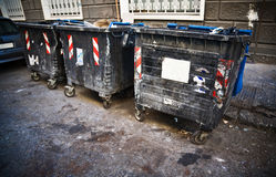 Dirty refuse bins. Street scene Royalty Free Stock Photo
