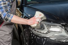 Dirty removal in the car floodlight Stock Photo