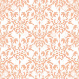 Dirty retro pattern. White abstract scroll shape like butterfly on litgh orange background Stock Photos
