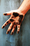 Dirty right hand with the palm stained with black Stock Images