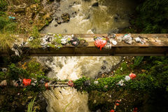 Dirty river flow with plastic waste photo taken in Bogor Indonesia Stock Photo