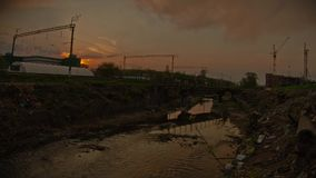 Dirty river and garbage in the industrial zone. stock footage