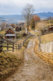 Dirty road in Carpathian village Stock Image