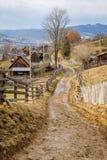 Dirty road in Carpathian village Stock Image