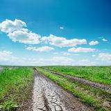 Dirty road close up and cloudy sky Royalty Free Stock Image