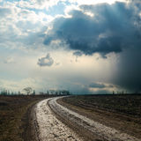 Dirty road to dramatic horizon Royalty Free Stock Image