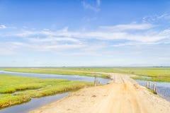 Dirty Road To Lagoa Do Peixe Lake With Wood Bridge Stock Photos