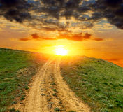 Dirty road to sunset Royalty Free Stock Image
