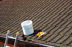 Dirty roof tiles and gutter requiring cleaning stock photography