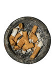 Dirty round ash tray with cigarette butts and stubs extinguished. Dirty round asht ray with cigarette butts and stubs extinguished royalty free stock photography