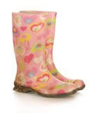 Dirty rubber boots stock images