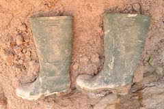 Dirty rubber boots Stock Photos