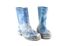 Dirty rubber boots isolated on white background Royalty Free Stock Photos