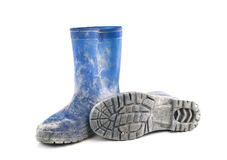 Dirty rubber boots isolated on white background Stock Photography