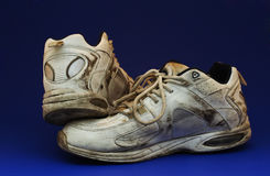 Dirty Running Shoe. Isolated dirty running shoe stock photography