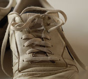 Dirty Running Shoe. Dirty old running shoe with laces undone Royalty Free Stock Photo