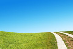 Dirty rural road in countryside Royalty Free Stock Photo
