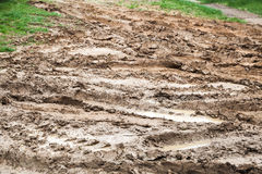 Dirty rural road with puddles and mud, countryside Royalty Free Stock Photos
