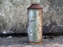 Dirty, Rusty Aerosol Can. A dirty, rusted, aerosol can . The can has dirt and other debris on it, and the label is almost completely removed Royalty Free Stock Photo