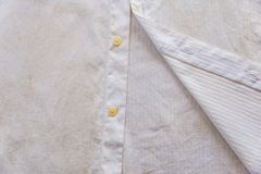 Dirty and rusty white shirt closeup. Royalty Free Stock Photo