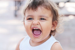 Dirty screaming baby Royalty Free Stock Images