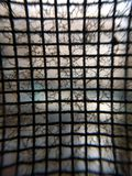 Dirty screen door closeup. Macro image of screen with cobwebs and dirt stock photo