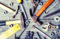 Dirty set of hand old tools. On a wooden panel royalty free stock photography