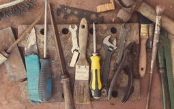 Dirty set of hand tools on a metal panel royalty free stock photography