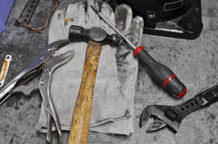Dirty set of hand tools on table, Assorted work tools on table. Royalty Free Stock Images