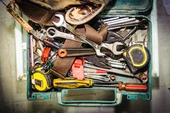 Dirty set of hand tools in tool box. Hand tools for air conditioner technician royalty free stock image