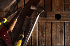 Dirty set of hand tools on  wooden panel Royalty Free Stock Images