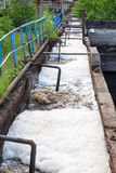 Dirty sewage water discharged in drainage Stock Photos