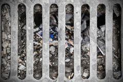 Dirty sewer on a street. Urban pollution. Drain. Dirty sewer on a street. Urban pollution. Grunge drain Royalty Free Stock Photo