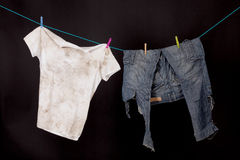 Dirty shirt and trousers Stock Photo
