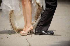 Dirty Shoes of Bride and Groom Royalty Free Stock Images